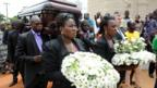 The casket containing the body of late author Chinua Achebe is carried to the funeral service in Ogidi, Nigeria on 23 May 2013