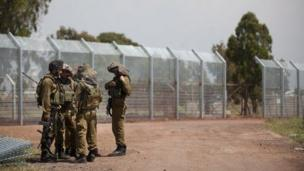 Israeli soldiers next to fence in occupied Golan Heights (file photo)