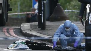 Police gather evidence at scene of Woolwich incident