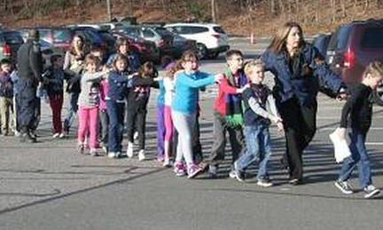 Children leave Sandy Hook School in Newtoen, Connecticut 14 December 2012