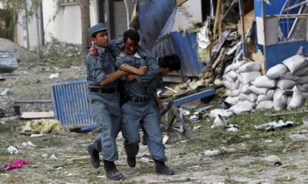 Wounded Afghan policeman being carried by colleagues in Kabul, 24 May 2013