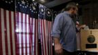 A voter casts his ballot in the village of Dixville Notch, where voting in the NH primary was held just after midnight 9 February 2016