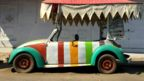 Stripey Volkswagen Beetle underneath a canopy shade