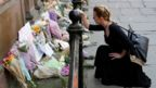 A woman lays flowers for the victims of the Manchester Arena attack.
