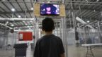 A boy watches tv