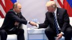 US President Donald Trump and Russian President Vladimir Putin shake hands during a meeting on the sidelines of the G20 Summit in Hamburg, Germany. July 7, 2017