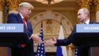 US president Donald Trump shakes Russian counterpart Vladimir Putin's hand