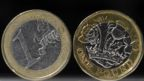 A British one pound sterling coin (R), and a one euro coin,