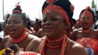 Royalist supporters dance and parade during the coronation ceremony of the newly crowned 40th Monarch of the Benin kingdom Oba Ewuare II in Benin City, midwest Nigeria, on October 20, 2016.