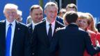 Mr Trump grins as Mr Macron kisses Angela Merkel