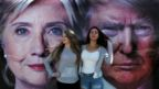Students at Hofstra University pose with a backdrop ahead of debate