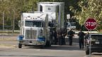Officials tow a truck that was found to contain 38 suspected illegal immigrants in San Antonio, Texas, USA, 23 July 2017.