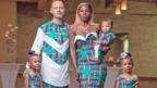 Justin and Aminat McClure pose in traditional Nigerian dress with their twin daughters and son