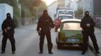 Special police officers secure a street near the house where a Syrian man lived before the explosion in Ansbach, southern Germany, Monday, July 25, 2016