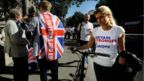 A vote remain supporter walks past a vote leave supporter outside Downing Street in London, Britain