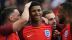 England striker Marcus Rashford (centre) is congratulated by team-mates after scoring against Australia