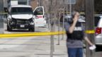 Police inspect a van suspected of being involved in fatal collision in Toronto on April 23, 2018