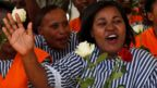 Cheering inmates holding flowers at Langata prison, Nairobi, Kenya - Tuesday 14 February 2017