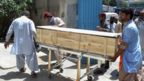 Pakistani security officials and hospital staff move a dead body into a morgue in Quetta on May 22, 2016, transported to the hospital following a drone strike in the remote town of Ahmad Wal in Balochistan that targeted Afghan Taliban Chief Mullah Akhtar Mansour.