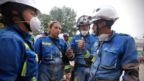Rescue workers from the Mexican Navy discuss what strategies could be employed to free earthquake survivors, Mexico City, 20 September 2017