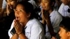 A girl celebrates after hearing some of her classmates had been potentially released from cave where they were trapped