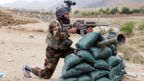 An Afghan soldier secures a check post in restive Achin district