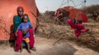 Fadumo, a mother of three children, with her one year old son Kulmiye