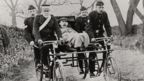 A man in a cycle ambulance from the 1910s