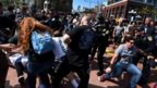 Police try to separate supporters and opponents of Donald Trump in San Diego, California. Photo: 27 May 2016