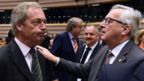 UK Independence Party (UKIP) leader Nigel Farage (L) talks with EU Commission President Jean-Claude Juncker