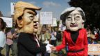 Demonstrators wearing Donald Trump and Theresa May paper mache heads join the protest in Butler's Cross, close to Chequers