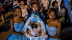 "Afro-Colombians hold a basket with ""Nino Dios"" (God Child) inside in Quinamayo, department of Valle del Cauca, Colombia, on February 18, 2018."
