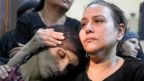 A mother of one of the victims of an attack on a group of Coptic Christians attends a funeral at the Sacred Family Church in Minya