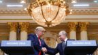"""U.S. President Donald Trump and Russia""""s President Vladimir Putin shake hands during a joint news conference after their meeting in Helsinki, Finland, July 16, 2018"""