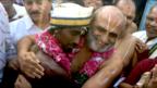 Mr Rangaran and Aditya are seen embracing.