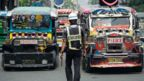 Jeepneys on a busy street in Manila