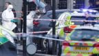 Police forensic officers at the scene close to the Houses of Parliament in London