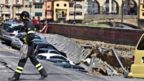 A firefighter walks next to a chasm near Ponte Vecchio, Florence, Italy, 25 May 2016