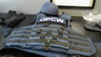 Bullet-proof vest and helmet used by OPCW staff, as demonstrated at its headquarters in The Hague, 20 April