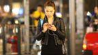 Woman with headphones in / iStock