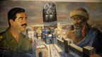 Saddam Hussein in a mural imagining him alongside Nebuchadnezzar (Credit: Getty Images)