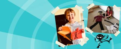 Two children show off their art work for the Art Ninja gallery: one girl has made a man walking a dog using towels and clothes laid flat on the floor, and a boy has made a secret pop up book using orange card and black felt tip.