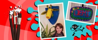 Art Ninja gallery, showing two pieces of art work: A boy (William) smiles beneath a giraffe head shield on the wall and A pop art room sign for a door handle, which says 'Demi'.