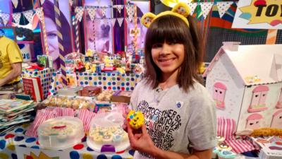 Great British Bake Off finalist Steph Blackwell with her Pudsey bear cakes.