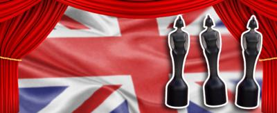 A Union Jack background with red curtains and three BRIT award statuettes.