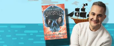 Justin Somper Author of Vampirates book series sat with an image of his book on a sea background with a pirate ship.