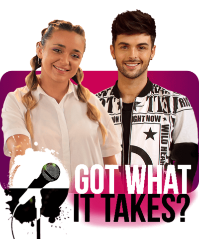 A girl with long blonde hair standing net to a boy with short dark hair smiling, Lauren and Jaymi from Got What It Takes.