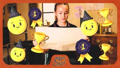 Girl in school uniform looking at large sheet of paper. Felicity Foxglove from The Worst Witch.