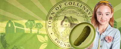 Holly Hobbie is standing in front of a Collinsville sign with a image of a pickle next to her.
