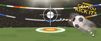 An in-game rendering of a football pitch with an audience. In the middle is a target on the ground and a target above it with a football connected with a dotted line.